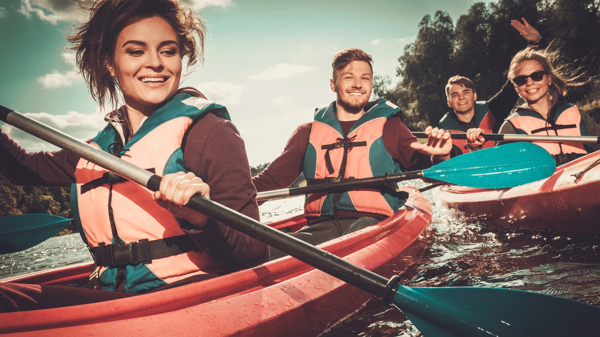 four people in kayaks