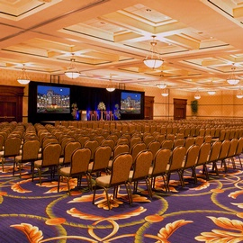 large ballroom with chairs and projection screens at hotel roanoke