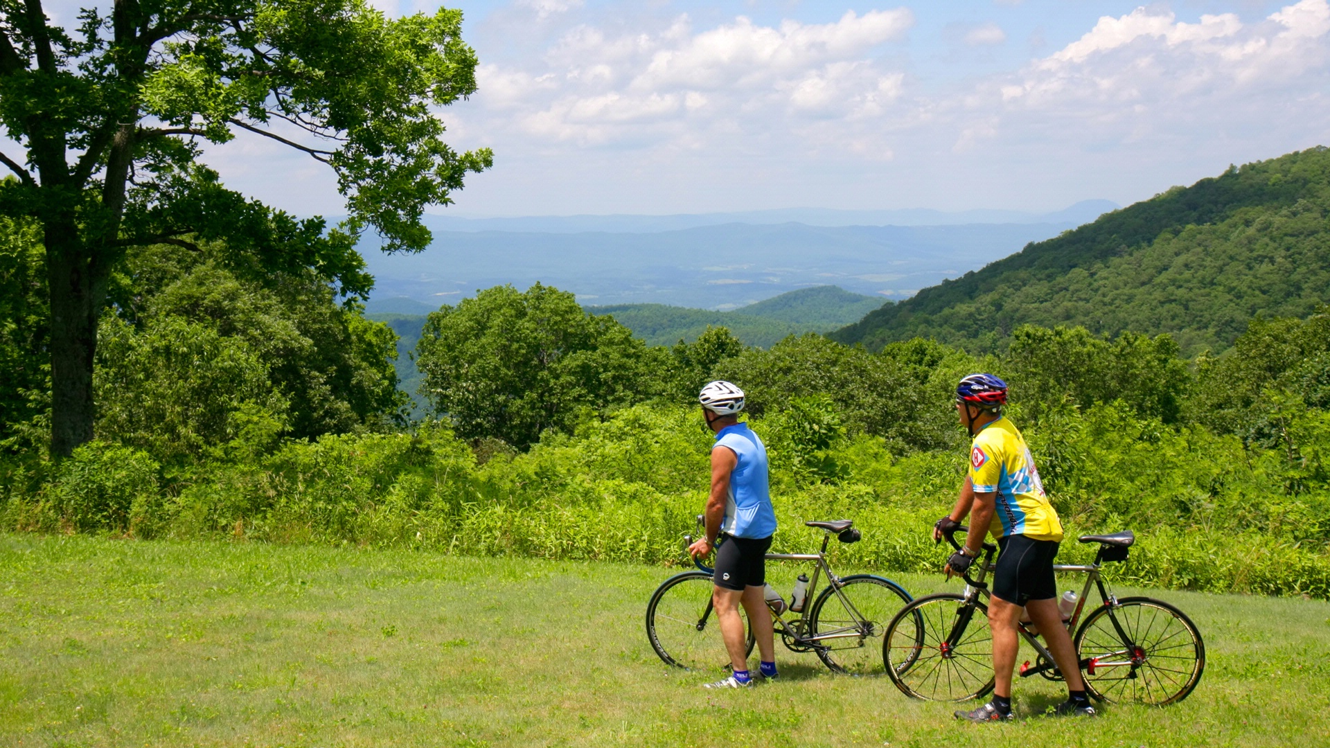 man and woman biking in the mountains near hotel roanoke