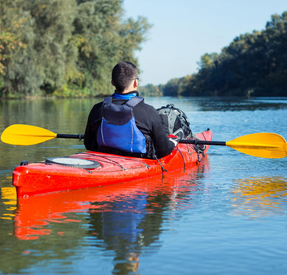 Person kayaking on a river